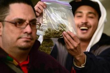 A man held up a bag of marijuana after Colorado voters approved legal recreational marijuana in 2012.