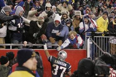 Rodney Harrison delivered a ball to a fan after the victory.