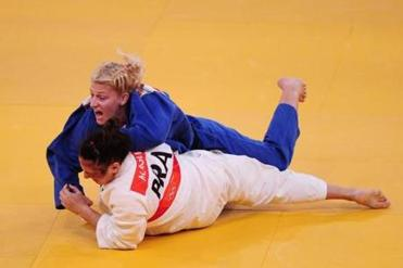 At the London Games, Kayla Harrison became the first American to win the gold in judo. Here, she competes against a Brazilian athlete.