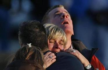 Families of victims grieved in the aftermath of the shootings.