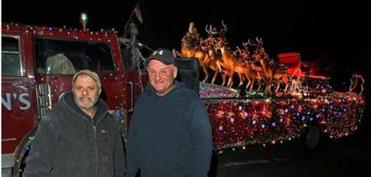 John Walsh Sr. (left), Rich Viger, and the firetruck that will bear the Clauses.
