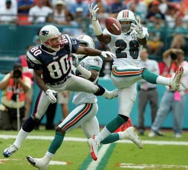 Dolphins safety Travares Tillman intercepted this Tom Brady pass intended for Troy Brown.