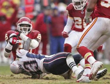 Deion Branch tackled the Chiefs' Greg Wesley after he made the third interception of the afternoon against Tom Brady.