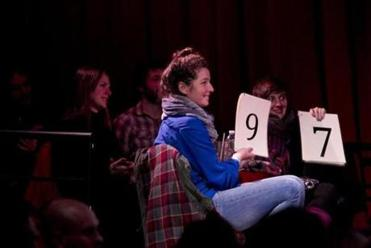At Oberon's December StorySLAM event, judges score a storyteller.