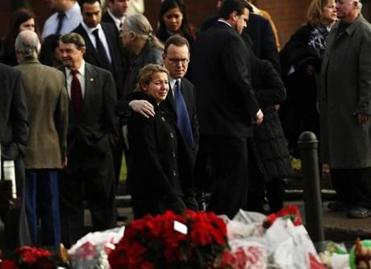 Mourners at the funeral of Jessica Rekos in Newtown, Conn.