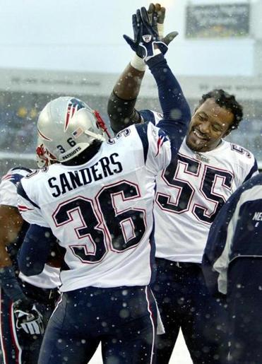 Willie McGinest congratulated James Sanders after his 39-yard interception return for a touchdown.