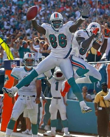 Dolphins receiver Marty Booker (86) celebrated with Chris Chambers after he scored a third-quarter touchdown.