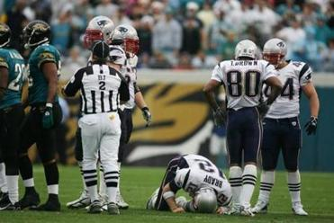 Tom Brady was knocked to the ground after a hard hit in the fourth quarter.