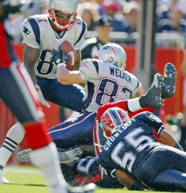 Wes Welker lateraled the ball to a surprised Randy Moss, who gained extra yardage on this completion.