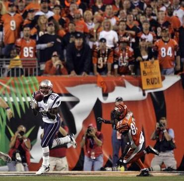 Asante Samuel intercepted Carson Palmer in front of Bengals receiver Chad Johnson during the second quarter.
