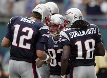 Wes Welker was congratulated after scoring on one of the nine catches he had Sunday.
