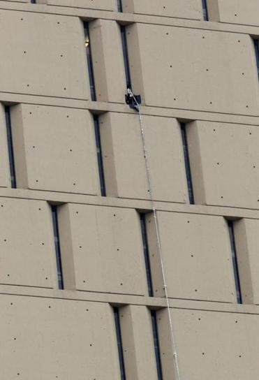 A rope believed used in the inmates' escapes hangs from the US jail in downtown Chicago. One inmate is still at large.