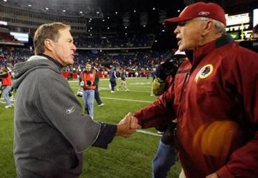 "Asked about his team's offensive churn late in the game, Patriots coach Bill Belichick (left, shaking hands with Redskins coach Joe Gibbs), said, ""What do you want us to do, kick a field goal?"""