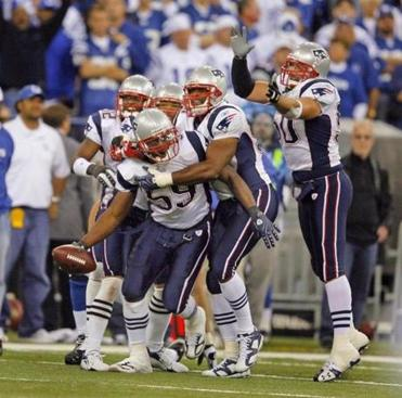 Rosevelt Colvin was mobbed by teammates after he recovered a fourth-quarter Peyton Manning fumble to seal the New England victory.