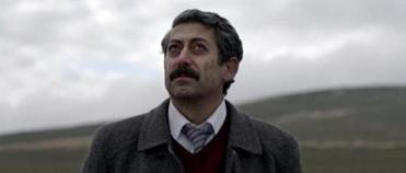 "Taner Birsel as Prosecutor Nusret in ""Once upon a time in Anatolia."""