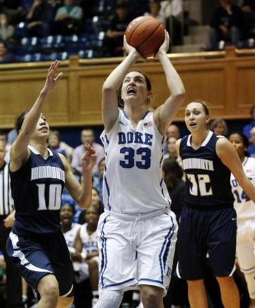 Duke's Haley Peters splits the defense of Monmouth's Chevannah Paalvast (left) and Betsy Gadziala for a basket during the second half of a lopsided affair in Durham, N.C.