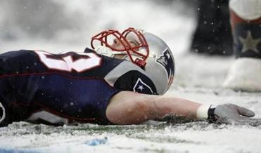 Wes Welker dropped into the snow after scoring a touchdown during the second quarter.
