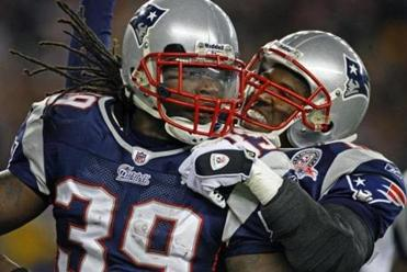 Matthew Slater (right) pounced on Laurence Maroney after one of the running back's two touchdowns.