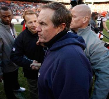 Patriots coach Bill Belichick shook hands with Browns coach Eric Mangini, his former assistant, after the loss.