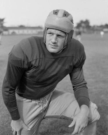 Pete Elliott was a standout quarterback at Michigan.