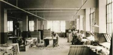 This photo shows the woodworking shop at the Norfolk State Prison Colony, circa 1932.