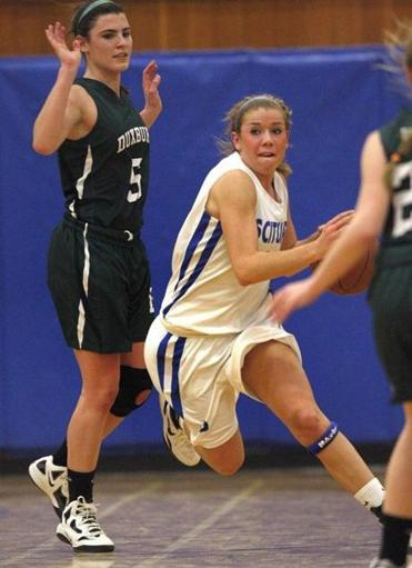 Despite being double-teamed by Duxbury defenders, Scituate High point guard Kelly Martin scored a team-high 17 points Tuesday.