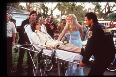 "A worried Cameron Diaz as Mary looked on as Ben Stiller as Ted is carried to an ambulance in ""There's Something About Mary."""