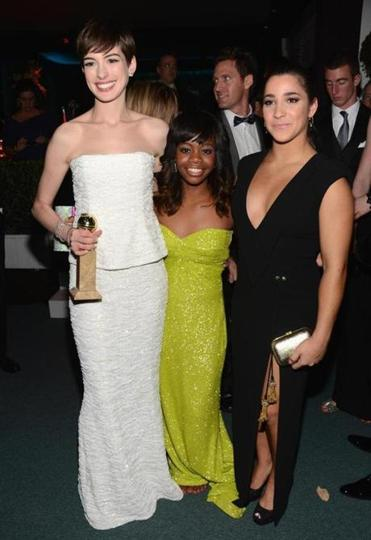 From left: Anne Hathaway, Gabby Douglas and Aly Raisman at the Golden Globe Awards in Los Angeles.