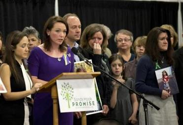 Family members of victims of the Sandy Hook Elementary School shootings attend a news conference Monday.