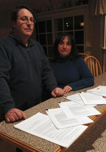 Tom and Carol Kelly, former assistant to Sovereign Bank's CEO, are in a stalemate with the bank.