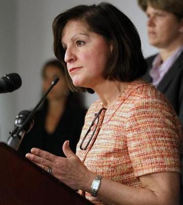 US Attorney Carmen Ortiz maintained her silence on the Aaron Swartz case and declined to comment on the posts by her husband, who could not be reached.
