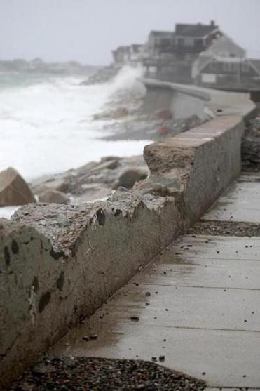 Parts of the town of Scituate's seawall were damaged by a ferocious winter storm. A look at part of that damage.