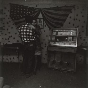 """Untitled [Couple Dancing in Front of Jukebox With Flag and JFK].''"