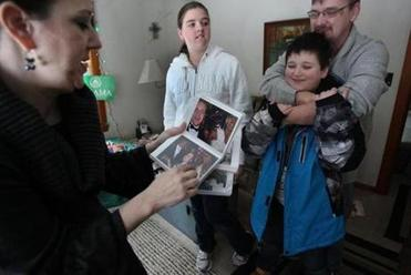 """It's not that Barack Obama became president and the world changed,"" said Kevin Meehan (seen above with Kirsten and their children, Seamus and Harper). ""Many people who voted for him have had some disappointments because change didn't happen overnight. . . . But it was incremental change. When all's said and done, we're trudging along."""