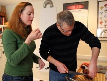 Chefs Carolyn Johnson and Bill Flumerfelt at home in their Cambridge kitchen, where each acknowledges the other's special expertise when they cook together.