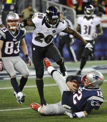 Tom Brady slid into Ravens free safety Ed Reed during the second quarter Sunday.