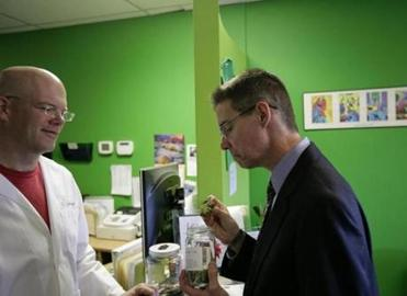 Patient Joel White, right, sniffed of his order while chatting with R. Greenleaf Organics, Inc. Executive Director Willie Ford.