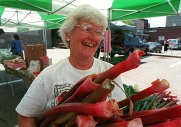 Joan Verrill, of Verrill Farms in Concord, holds a bunch of rhubarb at her stand.