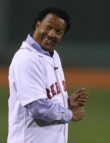 Pedro Martinez walking onto the field to throw out the first pitch before the Boston Red Sox played the New York Yankees at Fenway Park on Easter Sunday April 4, 2010.