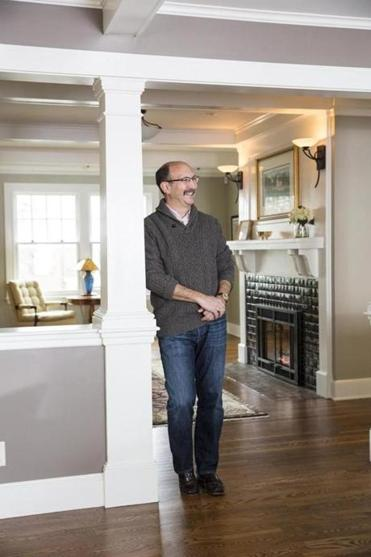 Steve Snider's living room features a new gas fireplace with an Arts and Crafts-style surround and the original mantel.