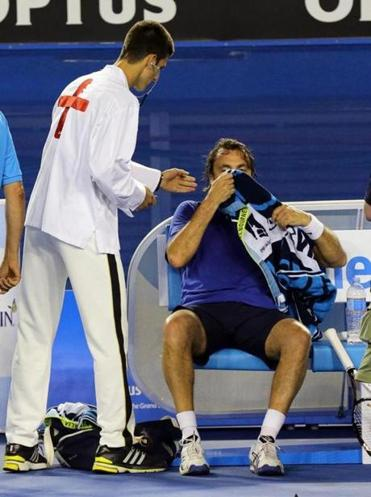 Much to the delight of the crowd, Novak Djokovic took a break from tennis duties to act as medic for Henri Leconte.