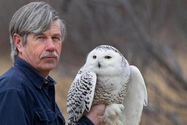 Norman Smith of the Massachusetts Audubon Society and the snowy owl who was tracked over the 7,000-mile journey.