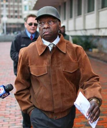 Onyango Obama in January 2013, leaving the JFK federal building after his arraignment on immigration charges.