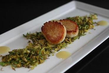 Seared scallops and shaved pan-fried Brussels sprouts.