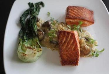 Hoisin-glazed salmon with mushroom risotto, grilled baby bok choy.