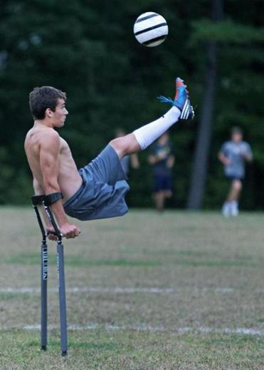 Nico Calabria, a varsity soccer player at Concord-Carlilse High School, who has only one leg, is pictured at a team practice session at the school.