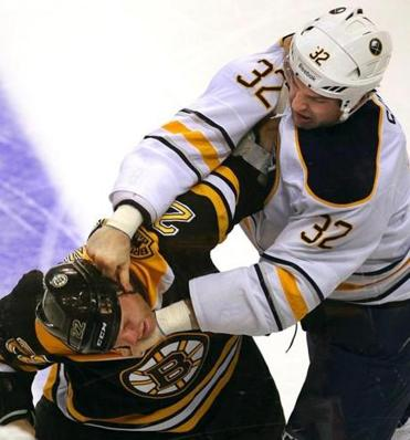Shawn Thornton left the game after this fight with Buffalo's John Scott on Thursday.