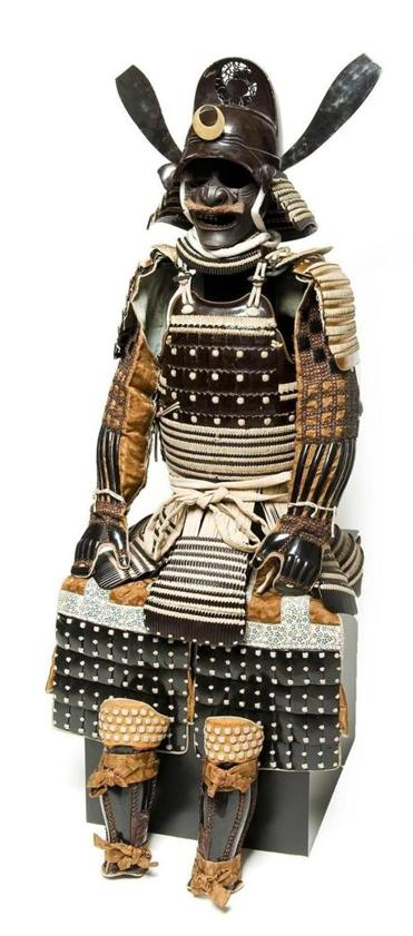 Domaru-type armor (left) and a pear-shaped gunpowder case are examples of the ornate samurai style.