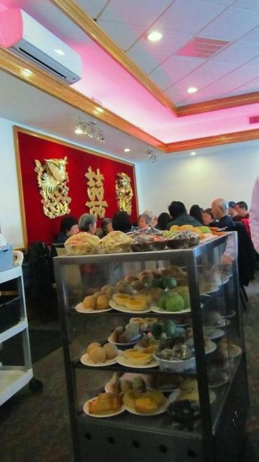 A pushcart is laden with dim sum offerings at Sun Kong in Malden.