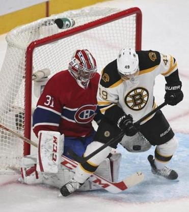 Montreal Canadiens goalie Carey Price made a glove save against Rich Peverley in the second period.